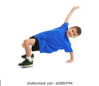 Little sportive boy posing on white background
