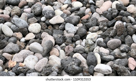 Little stones on the beach for backgrounds