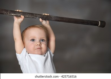 Little strong baby toddler playing sports. Kid during his workout. Success and winner concept