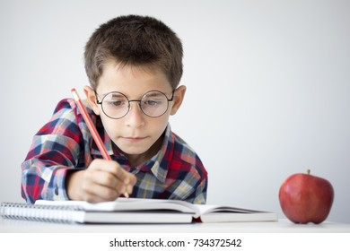 Little student boy on isolated background