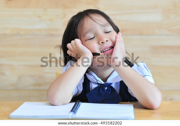 little student girl close eyes sign think