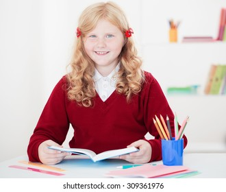 little student girl studying and reading book