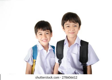 Little student sibling boy in uniform on white background
