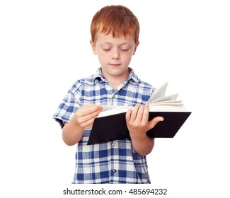 Little studious boy reading a book, isolated on white background
