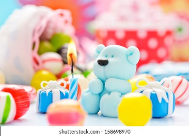little sugar teddy with a candle and candies