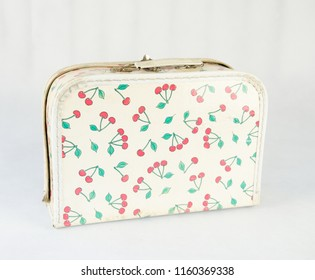 Little suitcase for children with cherry pattern - cheerful accessary isolated