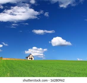 little summer house in grass field