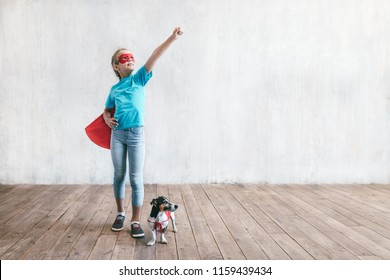 Little superhero with a dog indoors