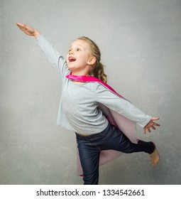 Little superhero girl mocking ability to fly