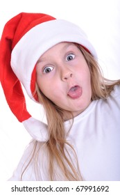 little surprised girl wearing a Santa Clause hat