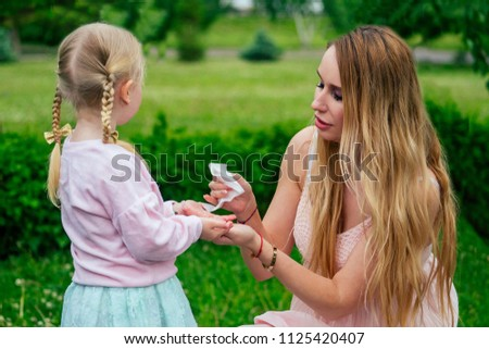Little And Sweet Blonde Girl In A Cute Gray Dress Together With Toothy Smile Beautiful Mother