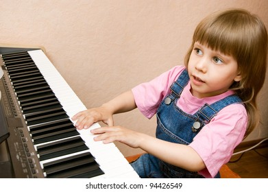Little sweet girl plays piano