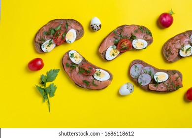 Little Tarts of quail eggs, Smoked Salmon, Cottage Cheese and tomatoes, copy space for your text. Yellow background