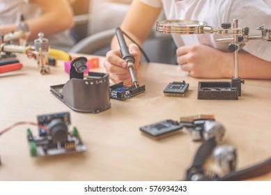Little technician using different appliance