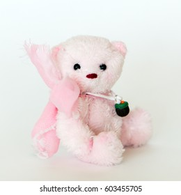 Little Teddy bear completely handmade from Velhobo with a pink bow.  Pink Ribbon