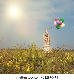 Little teenager child girl  with balloons in summer day