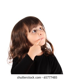 Little three year old brunette little girl holding her finger close to her nose with a thinking expression with copy space
