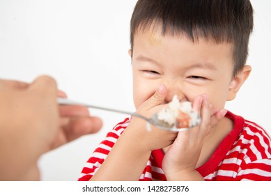 Little toddler Asian boy with hand close his mouth no eat his food