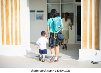 Little toddler boy cry, first day at school kindergarten with mother