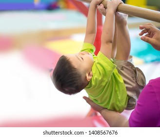 Little toddler boy working out at the indoor gym excercise