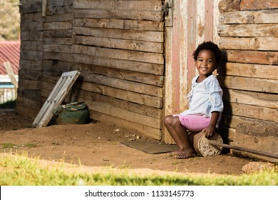 Little toddler girl looking straight into the camera with a huge smile on her face