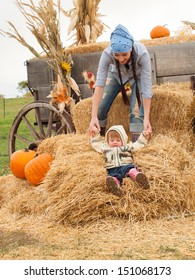 Little toddler with her mom on the farm.