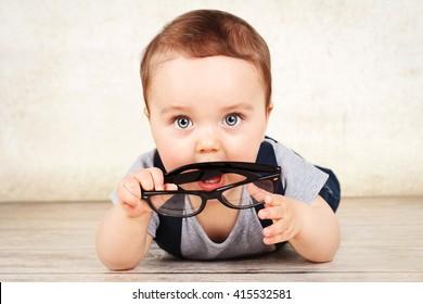 Little toddler holding glasses