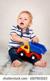 Little toddler playing with a car
