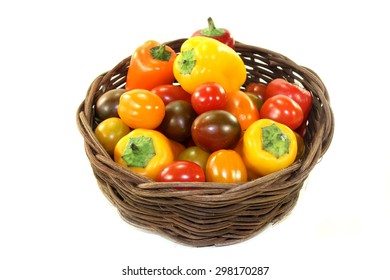 little tomatoes and peppers in a small basket