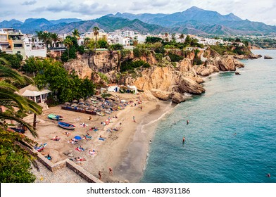 Little touristic town Nerja in Costa del Sol, Andalusia, Spain. It has many restaurants, bars and cafes. Aerial view of the beach