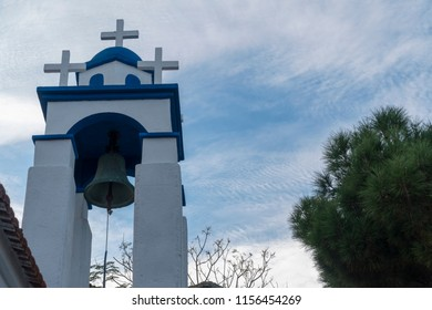 little tower and bell of a blue church
