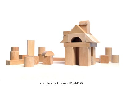Little town house of natural colored toy blocks on white background