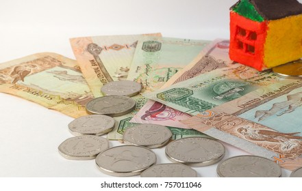 Little toy concept house on the banknotes of AED.