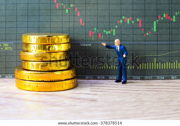 A little trader is taking profit from his stock. trading investment concept.