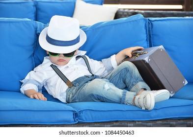 Little traveler relaxing in a lounge