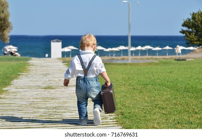 Little traveler walking to the beach. Rhodes, Greece