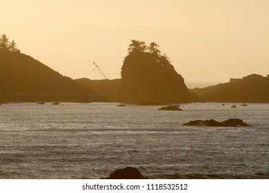 Little Trinidad Head and offshore rocks at sunset, Trinidad Bay, California, USA