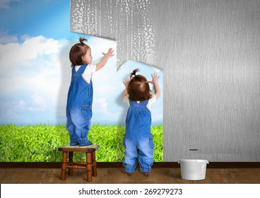 Little twins doing repair at home, hanging wallpaper. Renovation concept.