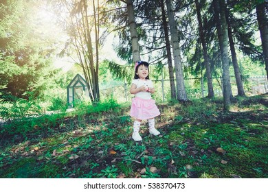 A little two years old asian girl in summer day in the jungle, a large portrait at Hokkaido Japan.