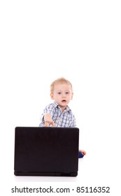 Little using laptop computer over white background