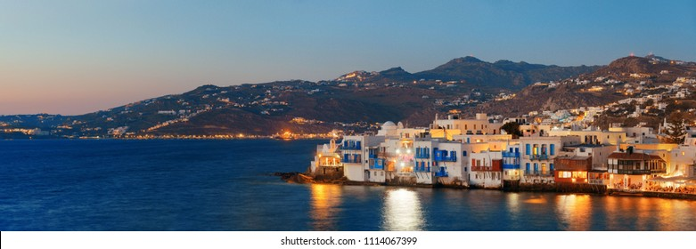 Little Venice and traditional Greek architecture evening panorama in Mykonos Island, Greece.