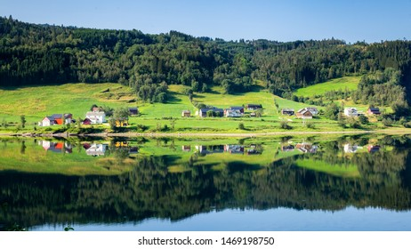 Little village along lake Vangsvatnet reflected in the water near Voss Hordaland county Norway