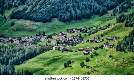 Little village of Colfosco on the hills with green meadow in summer season, Alta Badia - Trentino-Alto Adige, Italy