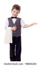 Little waiter standing with towel and inviting to pass, isolated on white
