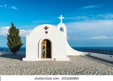 Little white chapel on the hill. Small church near Faliraki, Greek town on the island of Rhodes.