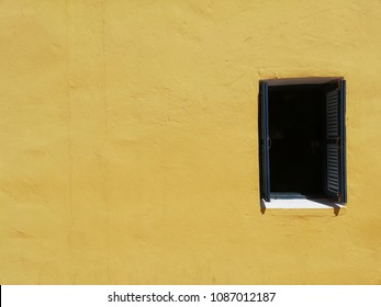 A little window on the yellow wall. The pastel yellow can make your warm feeling. Classic wall from the pass is a cool design.