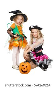 Little Witch and Charming Female Pirate going to Halloween or Carnival Party