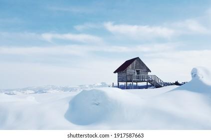 A little wooden cottage on a snow-covered field captured in Kulakkaya Plateau, Giresun, Turkey