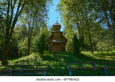 Little wooden historical church in a forest.