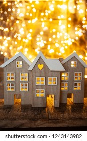 Little wooden houses in front of cozy bokeh lights